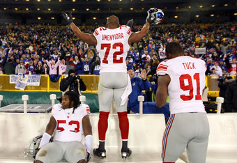 GREEN BAY, WI - JANUARY 15:   Osi Umenyiora #72 of the New York Giants celebrates after defeating the Green Bay Packers during their NFC Divisional playoff game at Lambeau Field on January 15, 2012 in Green Bay, Wisconsin.  (Photo by Jamie Squire/Getty Im
