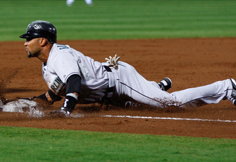 ATLANTA, GA - SEPTEMBER 12:  Emilio Bonifacio #1 of the Florida Marlins slides safely into third base against the Atlanta Braves in the third inning at Turner Field on September 12, 2011 in Atlanta, Georgia.  (Photo by Kevin C. Cox/Getty Images)