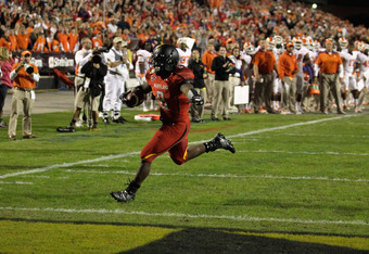COLLEGE PARK, MD - OCTOBER 15:  Running back Davin Meggett #8 of the Maryland Terrapins celebrates while running into the endzone for a touchdown against the Clemson Tigers during the first half at Byrd Stadium on October 15, 2011 in College Park, Marylan