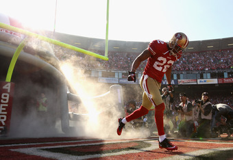 SAN FRANCISCO, CA - JANUARY 14:  Carlos Rogers #22 of the San Francisco 49ers runs out on to the field for the start of the NFC Divisional playoff game against the New Orleans Saints at Candlestick Park on January 14, 2012 in San Francisco, California.  (