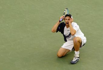 FLUSHING, NY - SEPTEMBER 7:  Andy Roddick celebrates match point against Juan Carlos Ferrero of Spain during the US Open men's singles final at Arthur Ashe Stadium in the USTA National Tennis Center on September 7, 2003 in Flushing, New York.  Roddick def