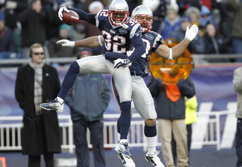 FOXBORO, MA - DECEMBER 24:  Devin McCourty #32 of the New England Patriots celebrates intercepting a Miami Dolphins pass with teammate Rob Ninkovich during the fourth quarter of New England's 27-24 win at Gillette Stadium on December 24, 2011 in Foxboro,