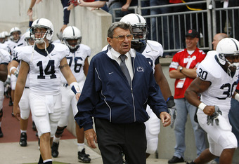 Coach Paterno leads the Nittany Lions out for a 1986 encounter with Ohio State.