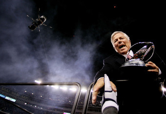 FOXBORO, MA - JANUARY 22:  Robert Kraft, team owner of the New England Patriots celebrates with the Lamar Hunt Trophy after his team defeated the Baltimore Ravens in the AFC Championship Game at Gillette Stadium on January 22, 2012 in Foxboro, Massachuset