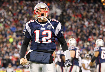 FOXBORO, MA - JANUARY 22:  Tom Brady #12 of the New England Patriots celebrates after scoring a touchdown in the fourth quarter against the Baltimore Ravens during their AFC Championship Game at Gillette Stadium on January 22, 2012 in Foxboro, Massachuset