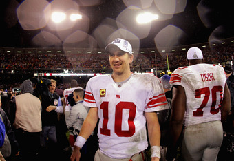 SAN FRANCISCO, CA - JANUARY 22:  Eli Manning #10 of the New York Giants celebrates after the GIants won 20-17 in overtime against the San Francisco 49ers during the NFC Championship Game at Candlestick Park on January 22, 2012 in San Francisco, California