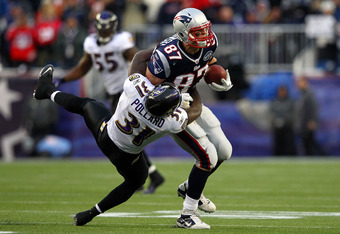 FOXBORO, MA - JANUARY 22:  Rob Gronkowski #87 of the New England Patriots gets tackle by Bernard Pollard #31 of the Baltimore Ravens during their AFC Championship Game at Gillette Stadium on January 22, 2012 in Foxboro, Massachusetts.  (Photo by Al Bello/
