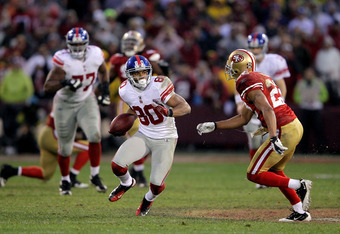 SAN FRANCISCO, CA - JANUARY 22:  Victor Cruz #80 of the New York Giants runs for yards after the catch against the San Francisco 49ers in the second quarter during the NFC Championship Game at Candlestick Park on January 22, 2012 in San Francisco, Califor