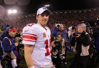 SAN FRANCISCO, CA - JANUARY 22:  Eli Manning #10 of the New York Giants walks off of the field after the Giants won 20-17 in overtime against the San Francisco 49ers during the NFC Championship Game at Candlestick Park on January 22, 2012 in San Francisco