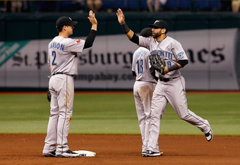 ST. PETERSBURG, FL - SEPTEMBER 23:  Infielder Kelly Johnson of the Toronto Blue Jays congratulates outfielder Jose Bautista #19 after their victory over the Tampa Bay Rays at Tropicana Field on September 23, 2011 in St. Petersburg, Florida.  (Photo by J.