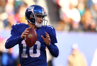 EAST RUTHERFORD, NJ - DECEMBER 18:  Eli Manning #10 of the New York Giants passes against the Washington Redskins during their game at MetLife Stadium on December 18, 2011 in East Rutherford, New Jersey.  (Photo by Al Bello/Getty Images)