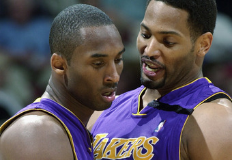 MINNEAPOLIS - APRIL 29:  Robert Horry #5 of the Los Angeles Lakers congratulates his teammate Kobe Bryant #8 in Game five of the Western Conference Quarterfinals against the Minnesota Timberwolves during the 2003 NBA Playoffs at Target Center on April 29,