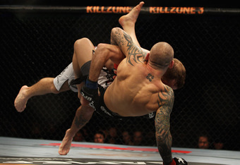 SYDNEY, AUSTRALIA - FEBRUARY 27:  Ross Pearson of Great Britain is tackled to the floor by Spencer Fisher of the USA during their Lightweight bout UFC 127 at Acer Arena on February 27, 2011 in Sydney, Australia.  (Photo by Mark Kolbe/Getty Images)