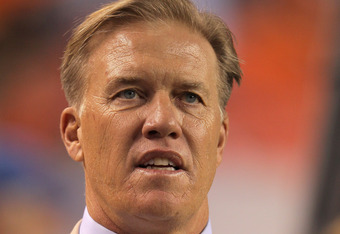 DENVER, CO - SEPTEMBER 12:  John Elway, Executive Vice President of Football Operations for the Denver Broncos, looks on from the sidelines prior to the Broncos game against the Oakland Raiders at Sports Authority Field at Mile High on September 12, 2011