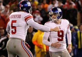 SAN FRANCISCO, CA - JANUARY 22:   Lawrence Tynes #9 and Steve Weatherford #5 of the New York Giants celebrate after Tynes kicked the game-winning field goal in overtime against the San Francisco 49ers during the NFC Championship Game at Candlestick Park o