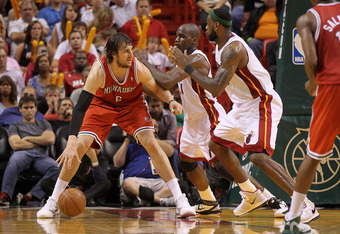 MIAMI, FL - APRIL 06:  Andrew Bogut #6 of the Milwaukee Bucks posts up  Joel Anthony #50 and LeBron James #6 of the Miami Heat during a game at American Airlines Arena on April 6, 2011 in Miami, Florida. NOTE TO USER: User expressly acknowledges and agree