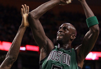 BOSTON, MA - JANUARY 16:  Kevin Garnett #5 of the Boston Celtics takes a shot in the first quarter against the Oklahoma City Thunder on January 16, 2012 at TD Garden in Boston, Massachusetts. NOTE TO USER: User expressly acknowledges and agrees that, by d