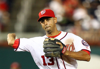 WASHINGTON, DC - JULY 27: Alex Cora #13 of the Washington Nationals throws a ball to first against the Florida Marlins at Nationals Park on July 27, 2011 in Washington, DC. The Marlins won 7-5. (Photo by Ned Dishman/Getty Images)