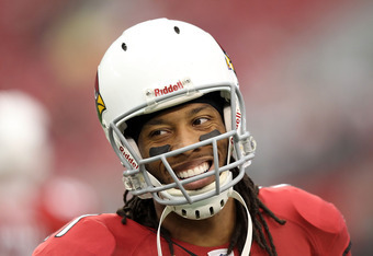 GLENDALE, AZ - JANUARY 01:  Wide receiver Larry Fitzgerald #11 of the Arizona Cardinals warms up before the NFL game against the Seattle Seahawks at the University of Phoenix Stadium on January 1, 2012 in Glendale, Arizona. The Cardinals defeated the Seah