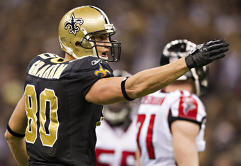 NEW ORLEANS, LA - DECEMBER 26:   Jimmy Graham #80 of the New Orleans Saints signals for a first down against the Atlanta Falcons at Mercedes-Benz Superdome on December 26, 2011 in New Orleans, Louisiana.  The Saints defeated the Falcons 45-16.  (Photo by
