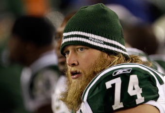 PHILADELPHIA, PA - DECEMBER 18:  Nick Mangold #74 of the New York Jets looks on from the sidelines during the second half against the Philadelphia Eagles  at Lincoln Financial Field on December 18, 2011 in Philadelphia, Pennsylvania.  (Photo by Rob Carr/G