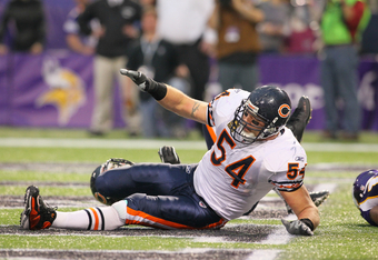 MINNEAPOLIS, MN - JANUARY 01:   Brian Urlacher #54 of the Chicago Bears awaits medical attention against the Minnesota Vikings at the Hubert H. Humphrey Metrodome on January 01, 2012 in Minneapolis, Minnesota.  (Photo by Adam Bettcher /Getty Images)