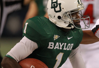 ARLINGTON, TX - NOVEMBER 26:  Kendall Wright #1 of the Baylor Bears runs the ball against Cornelius Douglas #2 of the Texas Tech Red Raiders at Cowboys Stadium on November 26, 2011 in Arlington, Texas.  (Photo by Ronald Martinez/Getty Images)