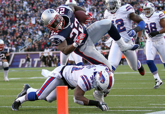 FOXBORO, MA - JANUARY 1:  Stevan Ridley #22 of the New England Patriots gains yards despite the defense of Jairus Byrd #31 of the Buffalo Bills at Gillette Stadium on January 1, 2012 in Foxboro, Massachusetts. (Photo by Jim Rogash/Getty Images)