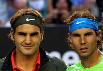 MELBOURNE, AUSTRALIA - JANUARY 26:  Roger Federer of Switzerland and Rafael Nadal of Spain plays pose for a photo before their semifinal match during day eleven of the 2012 Australian Open at Melbourne Park on January 26, 2012 in Melbourne, Australia.  (P