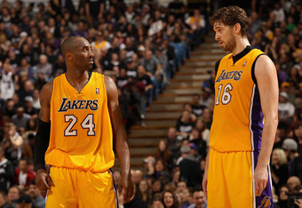 SACRAMENTO, CA - DECEMBER 26:  Kobe Bryant #24 talks to Pau Gasol #16 of the Los Angeles Lakers during their game against the Sacramento Kings at Power Balance Pavilion on December 26, 2011 in Sacramento, California.  NOTE TO USER: User expressly acknowle