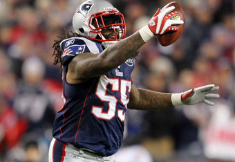 FOXBORO, MA - JANUARY 22:  Brandon Spikes #55 of the New England Patriots celebrates after intercepting a pass from Joe Flacco (not pictured) #5 of the Baltimore Ravens in the fourth quarter during their AFC Championship Game at Gillette Stadium on Januar