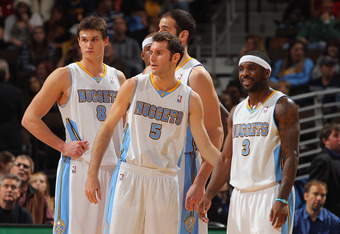 DENVER, CO - JANUARY 09:  Rudy Fernandez #5, Danilo Gallinari #8, Ty Lawson #3, Kosta Koufos #41 and Al Harrington #7 of the Denver Nuggets prepare to face the New Orleans Hornets at the Pepsi Center on January 9, 2012 in Denver, Colorado. The Hornets def