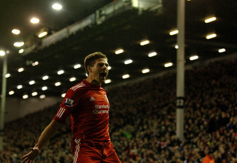 LIVERPOOL, ENGLAND - DECEMBER 30:  Steven Gerrard of Liverpool celebrates scoring his team's third goal during the Barclays Premier League match between Liverpool and Newcastle United at Anfield on December 30, 2011 in Liverpool, England.  (Photo by Clive