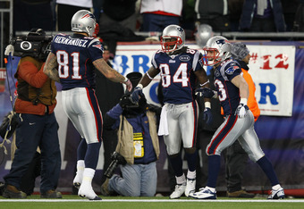 FOXBORO, MA - JANUARY 14:  (L-R) Aaron Hernandez #81, Deion Branch #84 and Wes Welker #83 of the New England Patriots celebrate after Branch scored a 61-yard touchdown reception in the second quarter against the Denver Broncos during their AFC Divisional