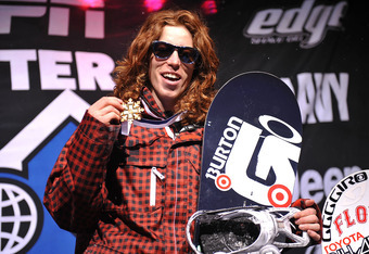ASPEN, CO - JANUARY 25: Shaun White of Carlsbad, California celebrates as he takes the podium for the gold medal in the Men's Snowboard Superpipe Final at Winter X Games 13 on Buttermilk Mountain on January 25, 2009 in Aspen, Colorado. White became the fi