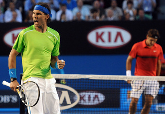 MELBOURNE, VICTORIA - JANUARY 26:  Rafael Nadal of Spain celebrates winning a point in his semifinal match against Roger Federer of Switzerland during day eleven of the 2012 Australian Open at Melbourne Park on January 26, 2012 in Melbourne, Australia.  (