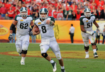 TAMPA, FL - JANUARY 02: Quarterback Kirk Cousins #8 of the Michigan State Spartans runs the ball against the Georgia Bulldogs in the Outback Bowl January 2, 2012 at Raymond James Stadium in Tampa, Florida. (Photo by Al Messerschmidt/Getty Images)