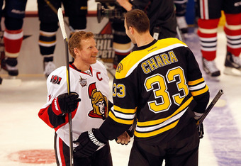 OTTAWA, ON - JANUARY 28:  Zdeno Chara #33 of the Boston Bruins and Team Chara and Team Chara talks with Daniel Alfredsson #11 of the Ottawa Senators and Team Alfredsson during the Blackberry NHL Hardest Shot part of the 2012 Molson Canadian NHL All-Star S