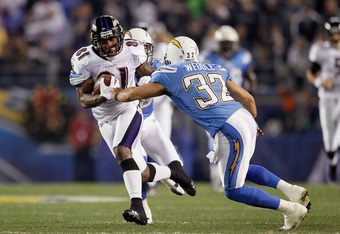 SAN DIEGO, CA - DECEMBER 18:   Wide receiver Anquan Boldin #81 of the Baltimore Ravens carries the ball before being brought down by Eric Weddle #32 of the San Diego Chargers in the first half at Qualcomm Stadium on December 18, 2011 in San Diego, Califor