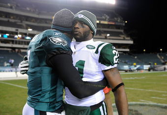 PHILADELPHIA, PA - DECEMBER 18:  LaDainian Tomlinson #21 of the New York Jets and Michael Vick #7 of the Philadelphia Eagles hug after a game at Lincoln Financial Field on December 18, 2011 in Philadelphia, Pennsylvania. The Philadelphia Eagles defeated t