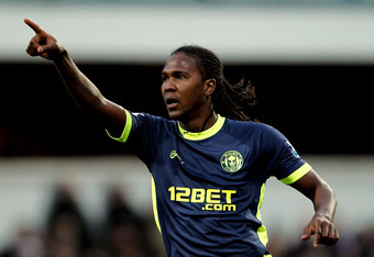 LONDON, ENGLAND - JANUARY 21:  Hugo Rodallega of Wigan celebrates after scoring a goal from a free kick during the Barclays Premier League match between Queens Park Rangers and Wigan Athletic at Loftus Road on January 21, 2012 in London, England.  (Photo