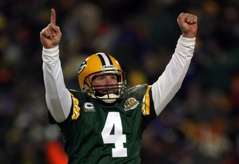 GREEN BAY, WI - JANUARY 20:  Quarterback Brett Favre #4 of the Green Bay Packers reacts after a Packers touchdown during the NFC championship game against the New York Giants on January 20, 2008 at Lambeau Field in Green Bay, Wisconsin. The Giants defeate