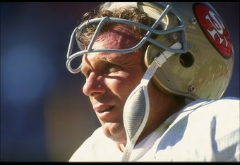 14 Oct 1990: A portrait of quarterback Joe Montana of the San Francisco 49ers as he stands on the sideline with his helmet off during a defensive series in the 49ers 45-35 victory over the Atlanta Falcons at Georgia Dome in Atlanta, Georgia.