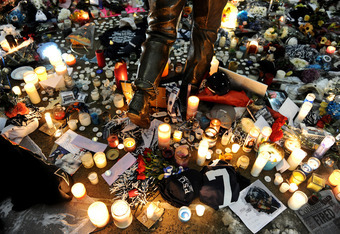 STATE COLLEGE, PA - JANUARY 22: Candles and other memorabilia  decorate the base of the statue of Joe Paterno, the former Penn State football coach who died earlier in the morning, outside Beaver Stadium on the campus of Penn State on January 22, 2012 in