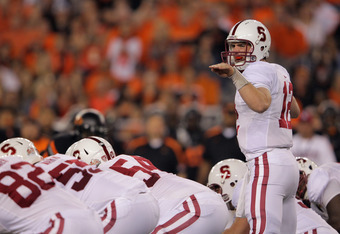 GLENDALE, AZ - JANUARY 02:  Andrew Luck #12 of the Stanford Cardinal gestures at the line against the Oklahoma State Cowboys during the Tostitos Fiesta Bowl on January 2, 2012 at University of Phoenix Stadium in Glendale, Arizona.  (Photo by Doug Pensinge