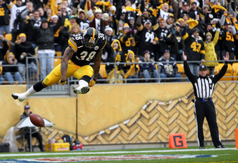PITTSBURGH, PA - DECEMBER 24:  John Clay #38 of the Pittsburgh Steelers celebrates after scoring a touchdown in the second quarter of the game against the St. Louis Rams at Heinz Field on December 24, 2011 in Pittsburgh, Pennsylvania.  (Photo by Karl Walt