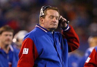 EAST RUTHERFORD, NJ - DECEMBER 28:  Head coach Jim Fassel of the New York Giants closes his eyes during their game against the Carolina Panthers December 28, 2003 at Giant Stadium in East Rutherford, New Jersey. This will be Fassel's last game with the Gi