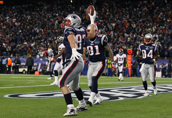 FOXBORO, MA - JANUARY 14:  Rob Gronkowski #87 of the New England Patriots celebrates by spiking the ball after he scored a 12-yard touchdown reception in the second quarter against the Denver Broncos during their AFC Divisional Playoff Game at Gillette St