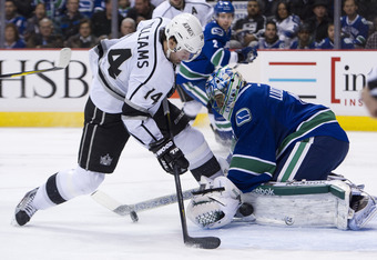 VANCOUVER, CANADA - JANUARY 17: Goalie Roberto Luongo #1 of the Vancouver Canucks stops Justin Williams #14 of the Los Angeles Kings in close during the third period in NHL action on January 17, 2012 at Rogers Arena in Vancouver, British Columbia, Canada.