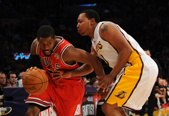 LOS ANGELES, CA - DECEMBER 25:  C.J. Watson #7 of the Chicago Bulls drives against Andrew Goudelock #0 of the Los Angeles Lakers at Staples Center on December 25, 2011 in Los Angeles, California.  NOTE TO USER: User expressly acknowledges and agrees that,